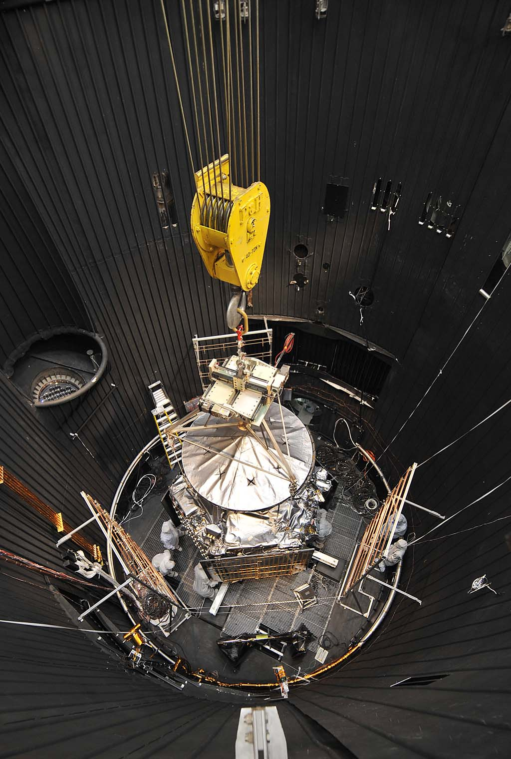 NASA's Juno spacecraft is readied for lifting out of a thermal vacuum chamber following testing to simulate the environment of space over the range of conditions the probe will encounter during its mission.