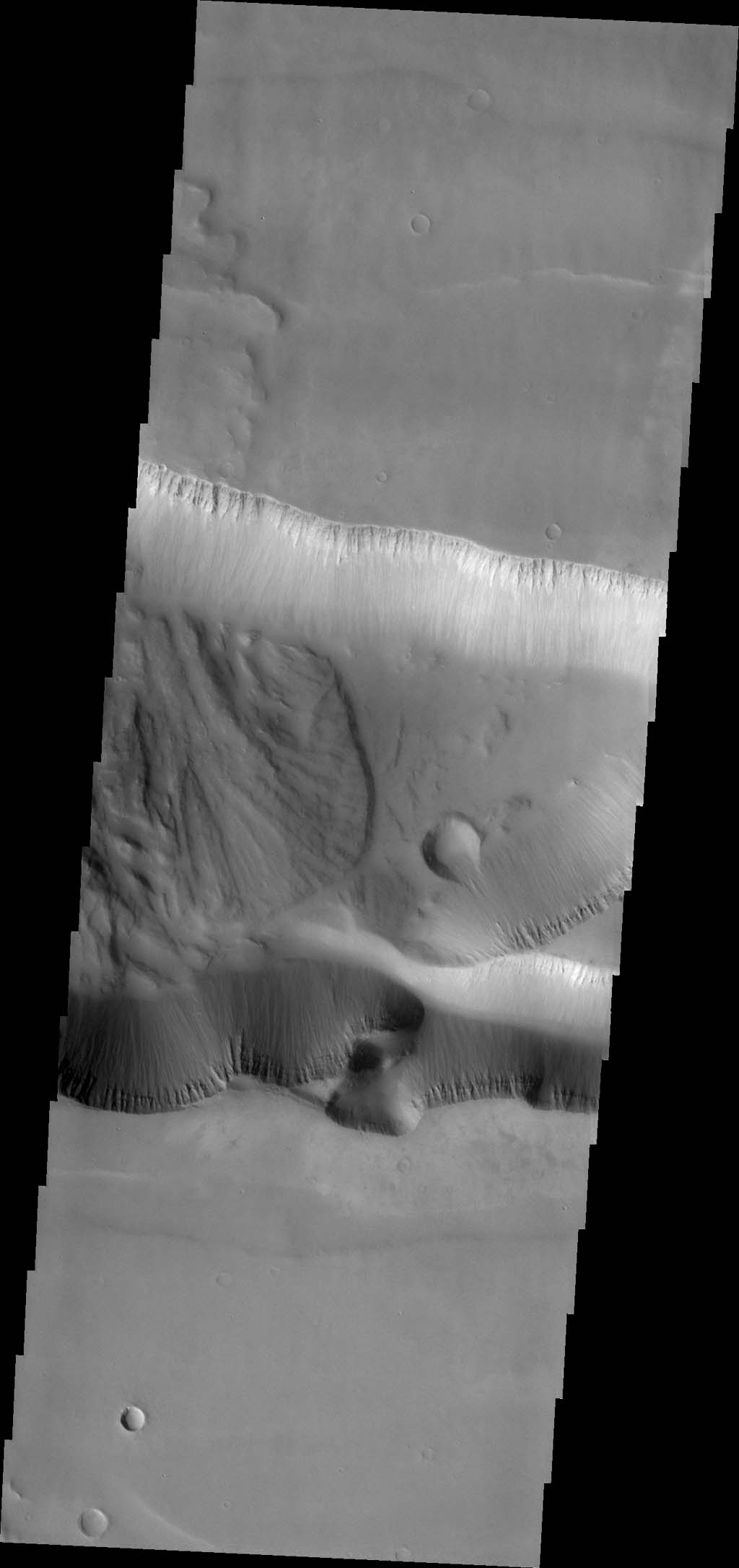 The landslide deposit in this image captured by NASA's Mars Odyssey is located in shallow extension of Tithonium Chasma, in the western part of Valles Marineris.
