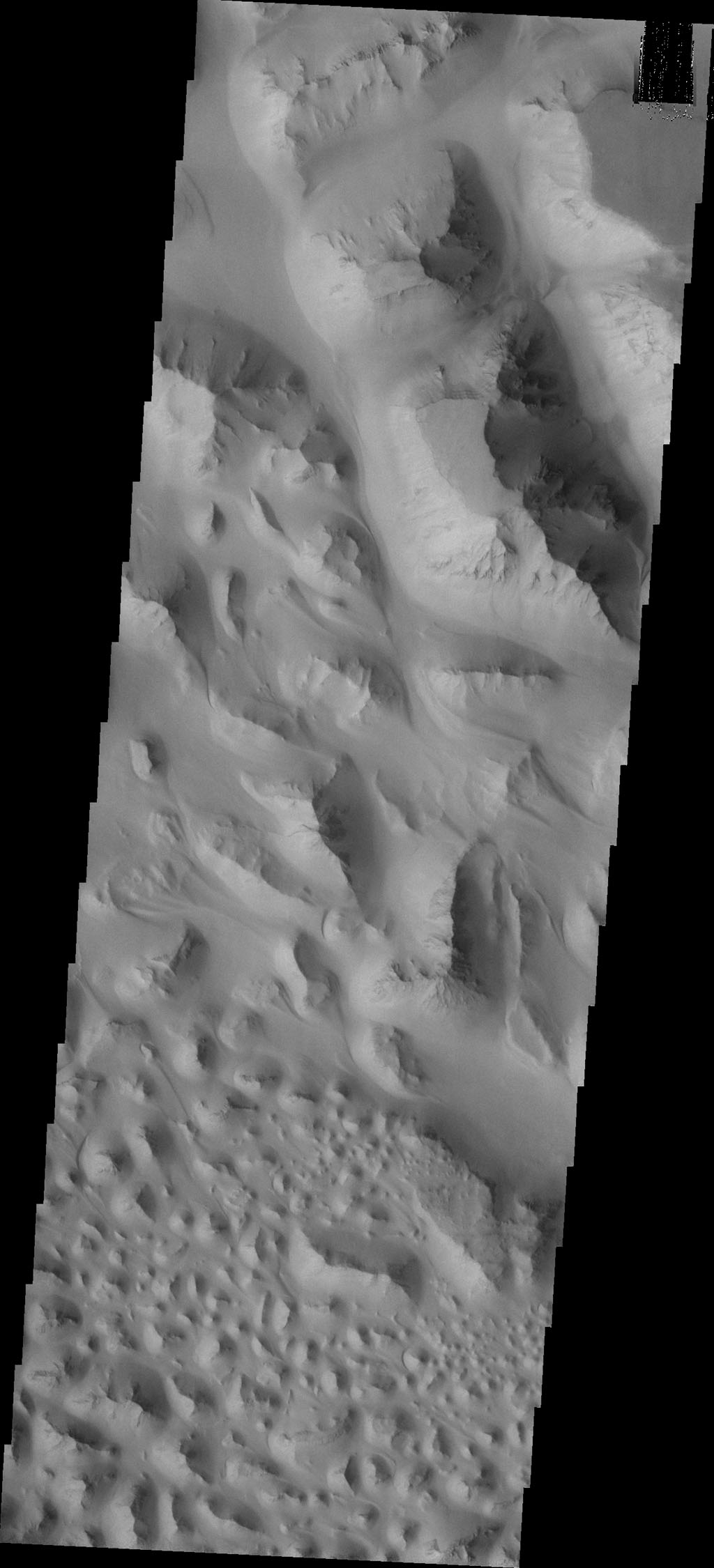 "The floor of Eos Chasma is composed of thousands of small hills; this type of terrain is called ""chaos."" This image from NASA's Mars Odyssey and shows a small portion of Eos Chaos."