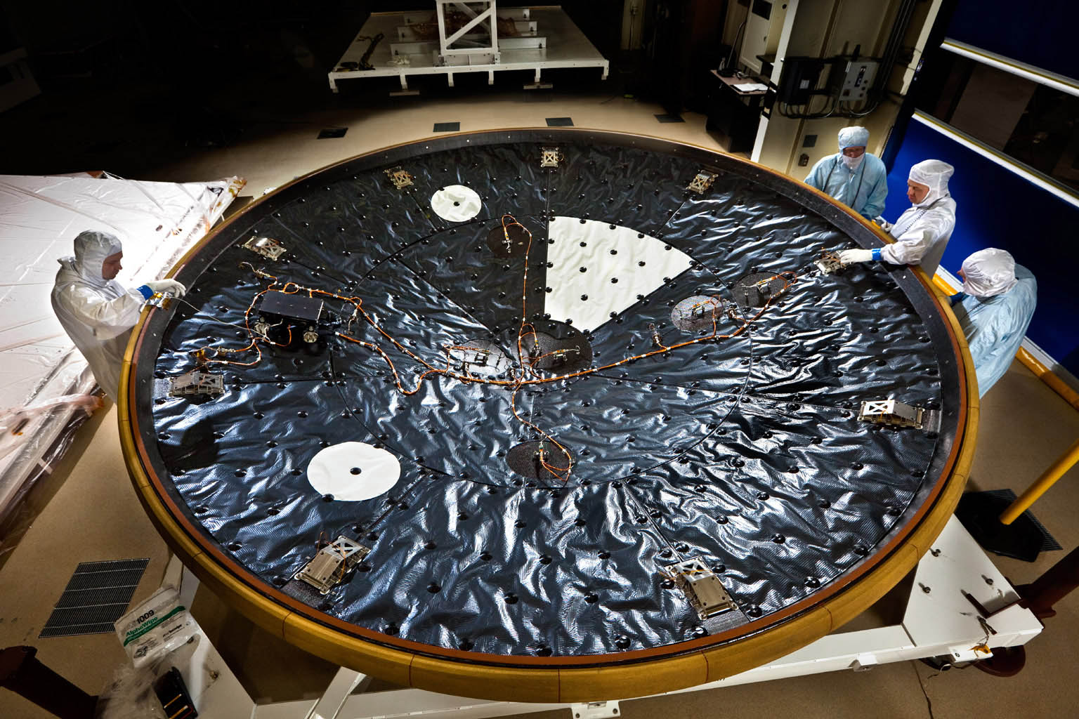 The heat shield for NASA's Mars Science Laboratory is the largest ever built for a planetary mission. This image shows the heat shield being prepared at Lockheed Martin Space Systems, Denver, in April 2011.