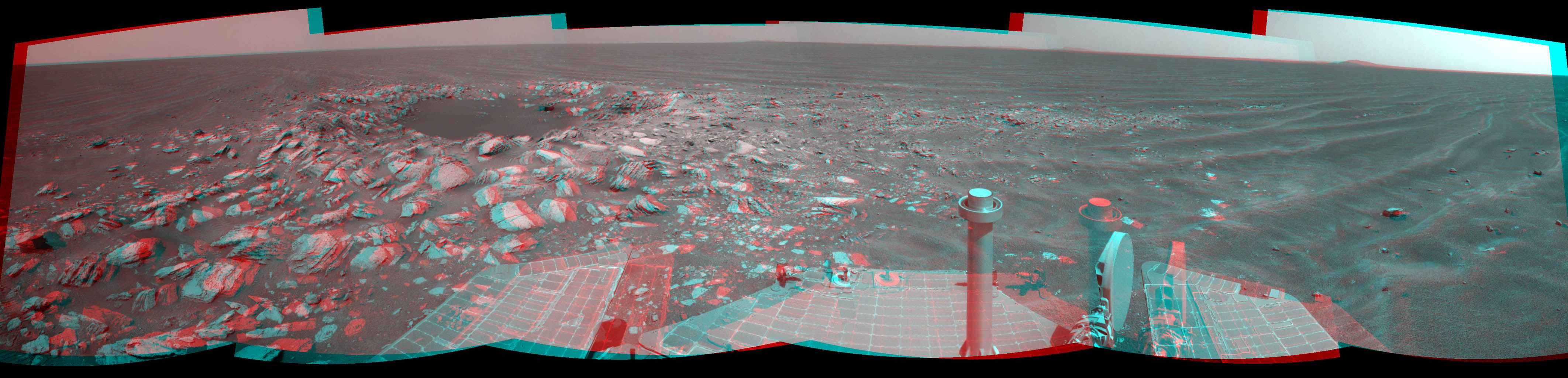 NASA's Mars Exploration Rover Opportunity captured this stereo view of a wee crater, informally named 'Skylab,' along the rover's route. This crater was likely formed within the past 100,000 years. 3-D glasses are necessary to view this image.