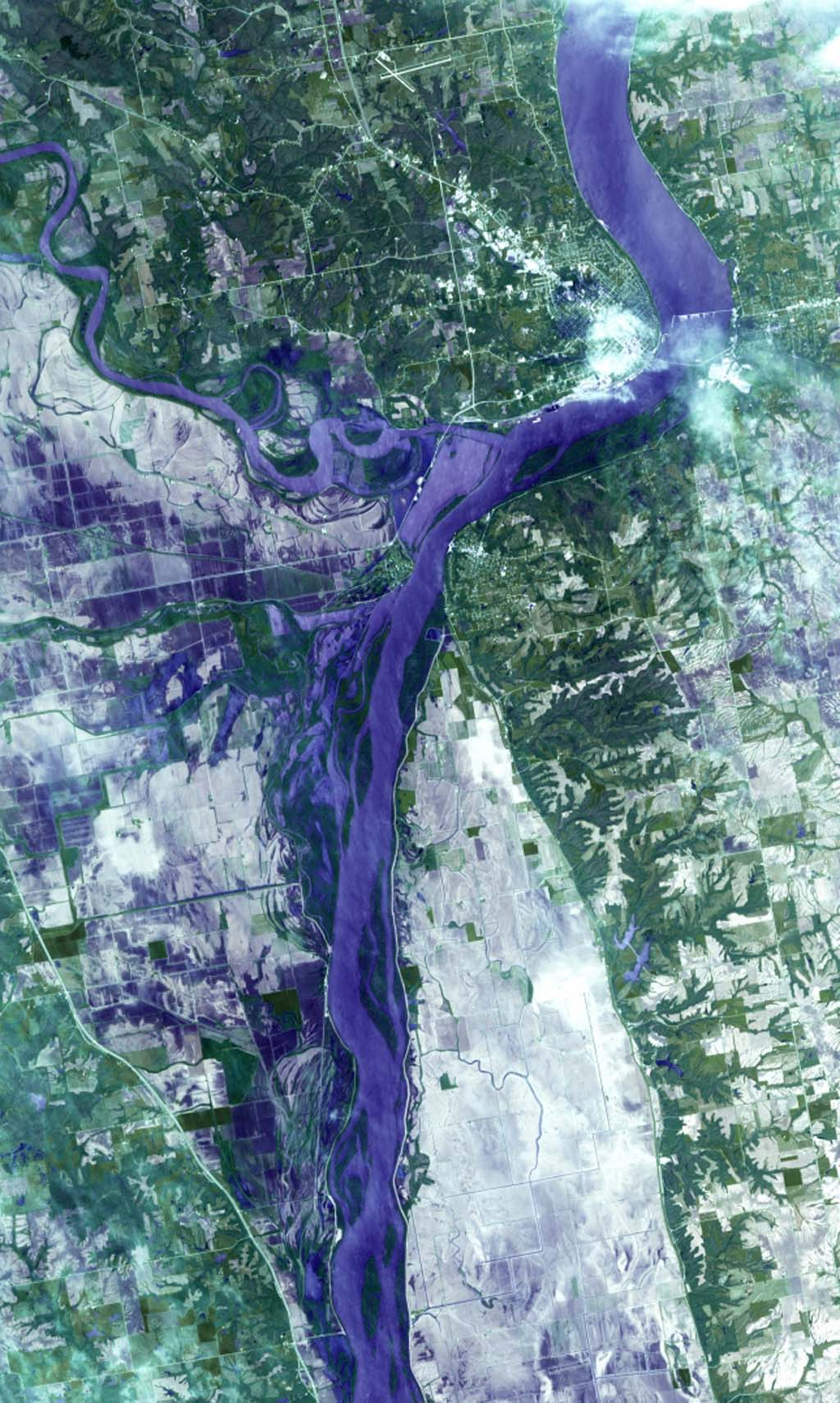 NASA's Terra spacecraft acquired this image on April 30, 2011, showing flooding along the Mississippi River at its junction with the Des Moines River near Keokuk, Iowa.
