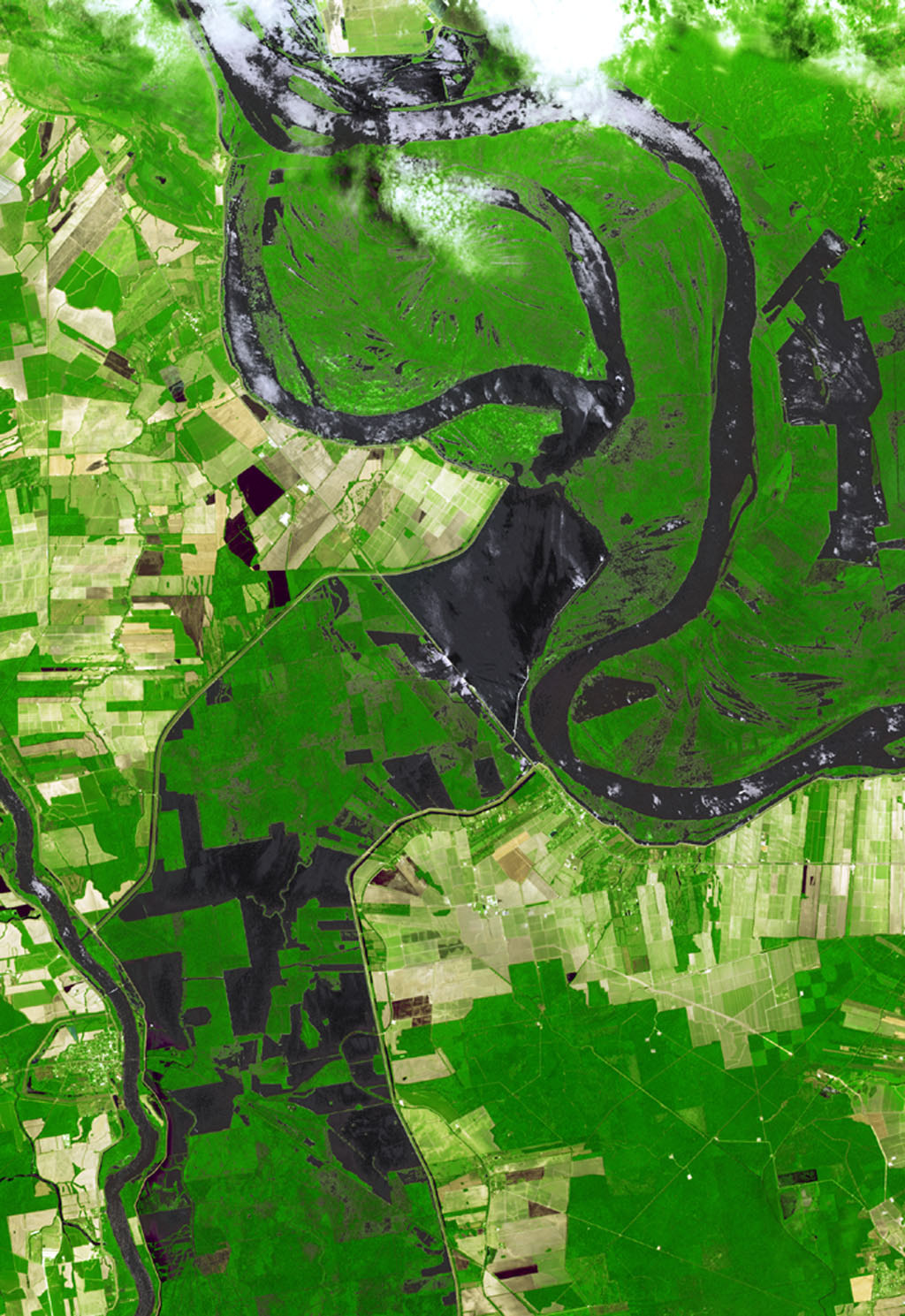 NASA's Terra spacecraft shows the water flow after the U.S. Army Corps of Engineers opened the Morganza Spillway, a flood control structure along the western bank of the Mississippi River in Louisiana, to ease flooding along levee systems on May 14, 2011.