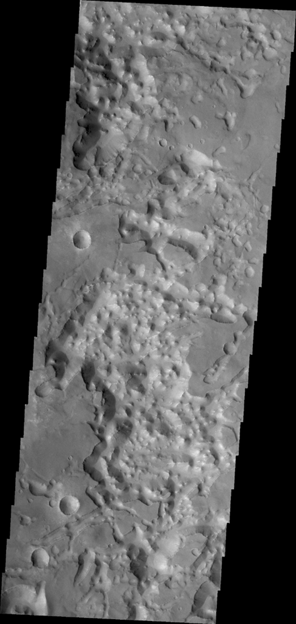 The eastern end of Valles Marineris opens into huge low lying channels filled with the mound and valley terrain called chaos. This image from NASA's 2001 Mars Odyssey shows part of Eos Chaos.