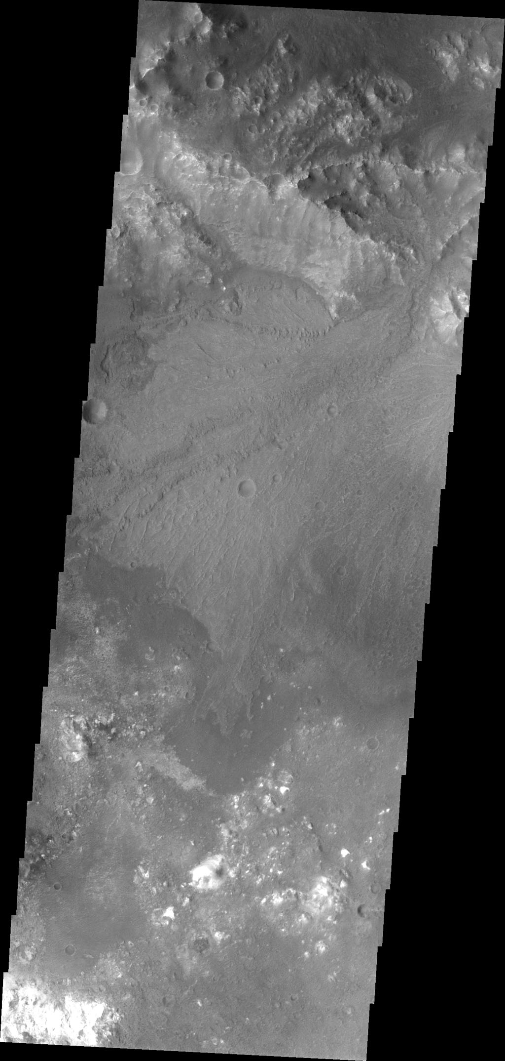 A beautiful delta deposit in Harris Crater is the highlighted feature in this image captured by NASA's 2001 Mars Odyssey.