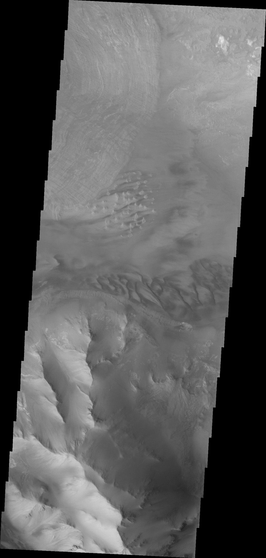 Dunes and the distal end of a landslide deposit are evident in this image from NASA's 2001 Mars Odyssey of eastern Ius Chasma.