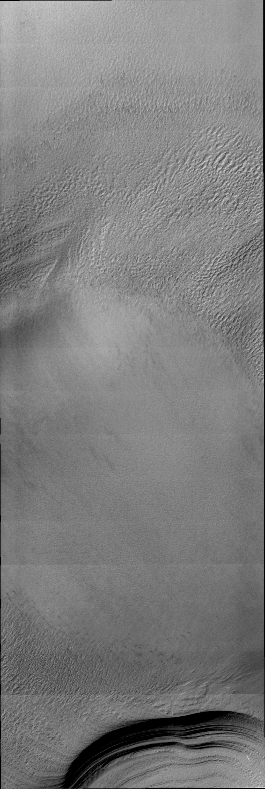 Different lighting can hide or reveal different features on the surface of Mars. The lighting was perfect to reveal the details of the layering of the south polar cap in this image from NASA's 2001 Mars Odyssey.