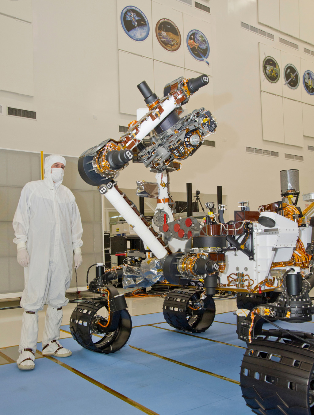 This photograph of the NASA Mars Science Laboratory rover, Curiosity, was taken during testing on June 3, 2011. The turret at the end of Curiosity's robotic arm holds five devices.
