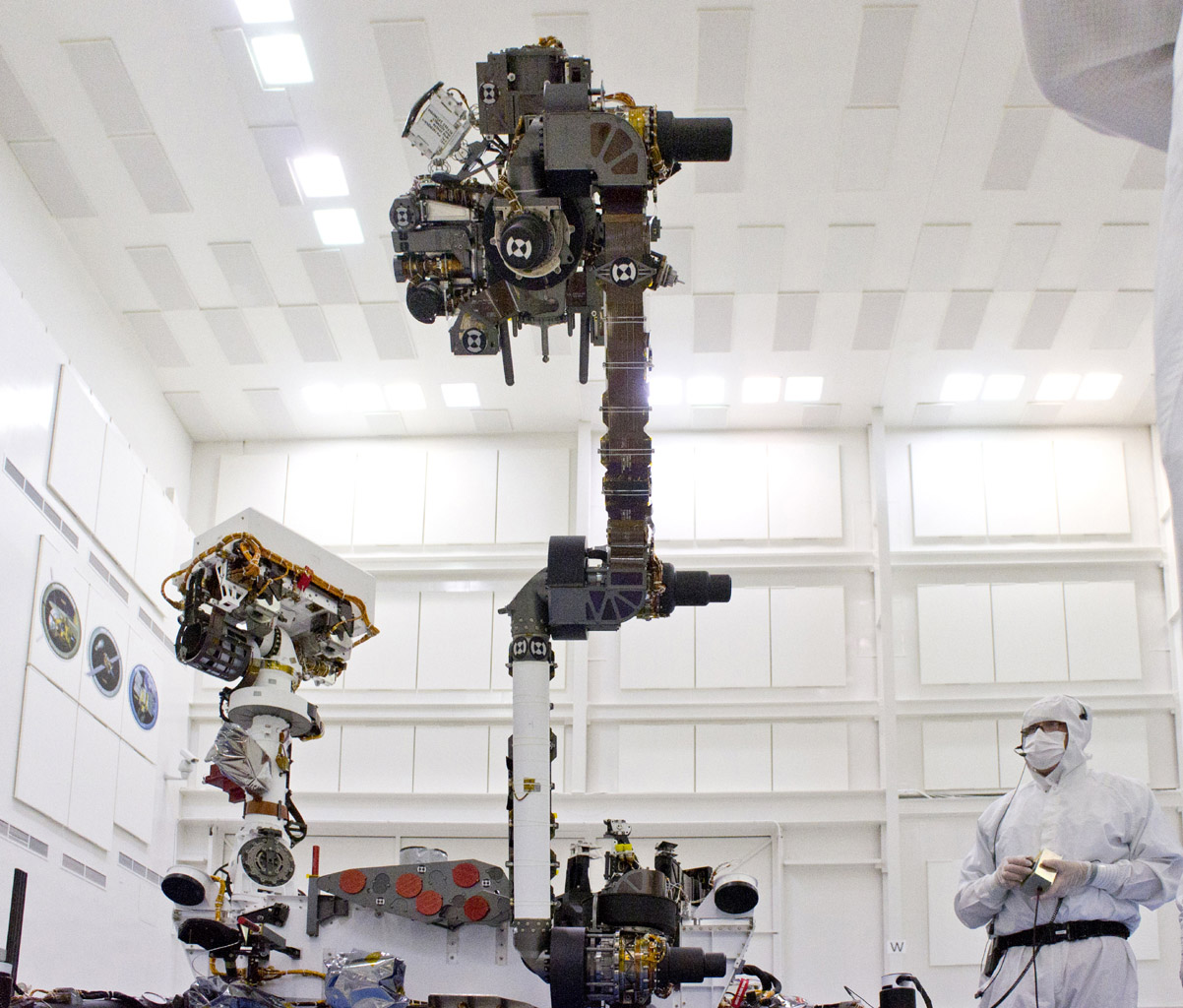 This photograph of the NASA Mars Science Laboratory rover, Curiosity, was taken during testing on June 3, 2011. The turret at the end of Curiosity's robotic arm holds five devices. In this view, the drill is at the six o'clock position.