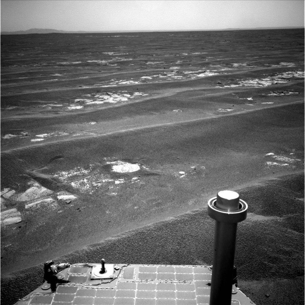 NASA's Mars Exploration Rover Opportunity used its navigation camera to record this view in the eastward driving direction after completing a drive on July 17, 2011, that took the rover's total driving distance on Mars beyond 20 miles.