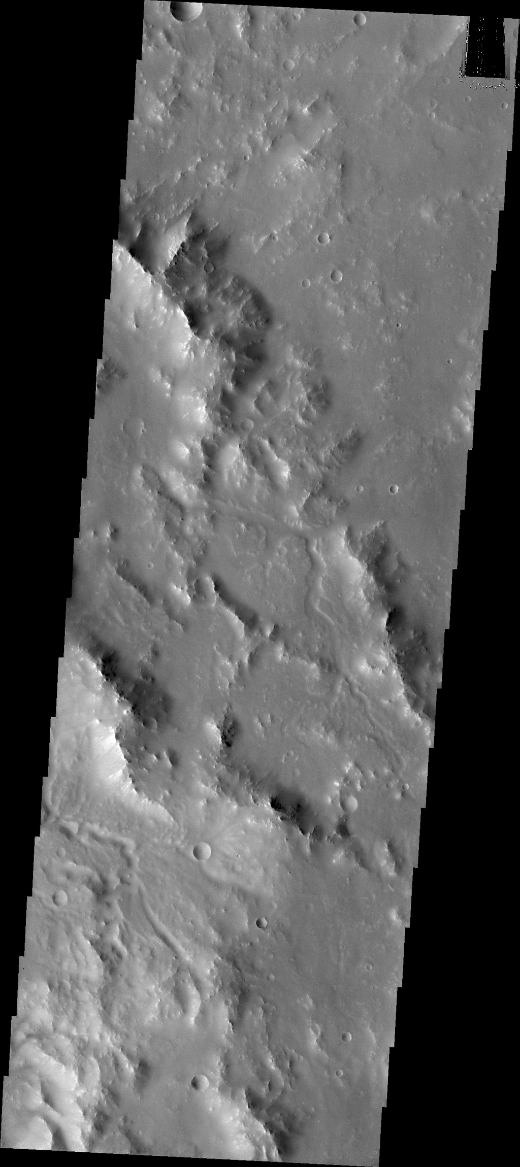 Small channels dissect the rim of Bakhuysen Crater in Noachis Terra as seen by NASA's 2001 Mars Odyssey.