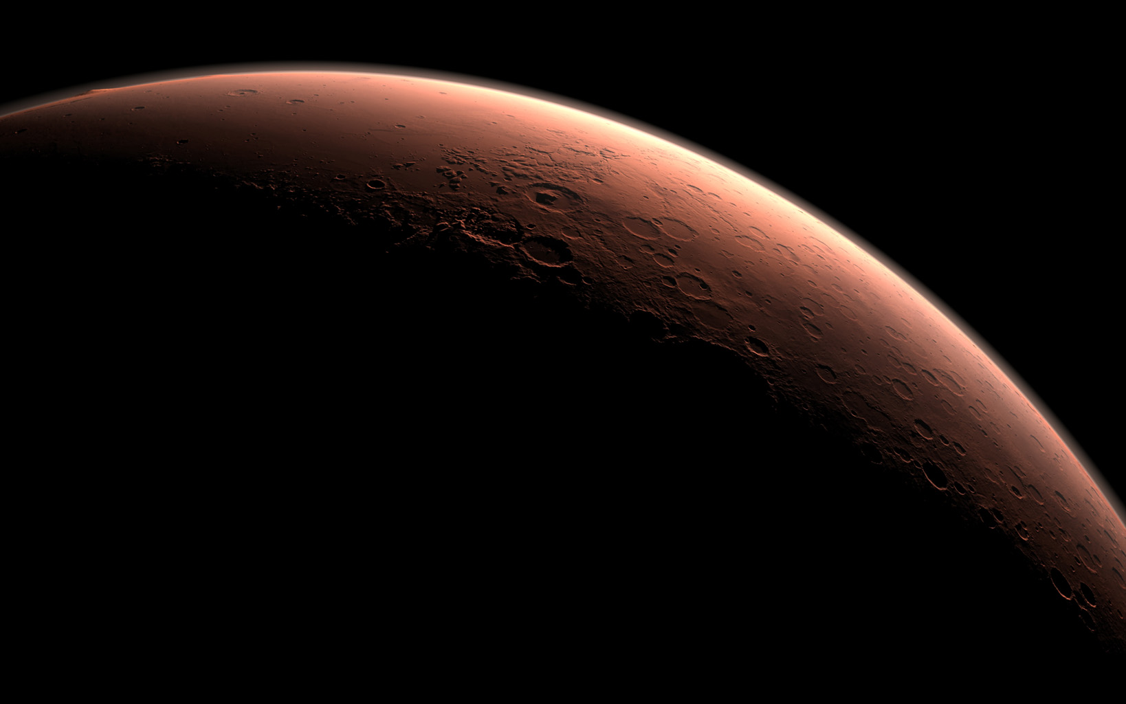 This computer-generated view depicts part of Mars at the boundary between darkness and daylight, with an area including Gale Crater beginning to catch morning light. NASA has selected Gale as the landing site for the Mars Science Laboratory mission.