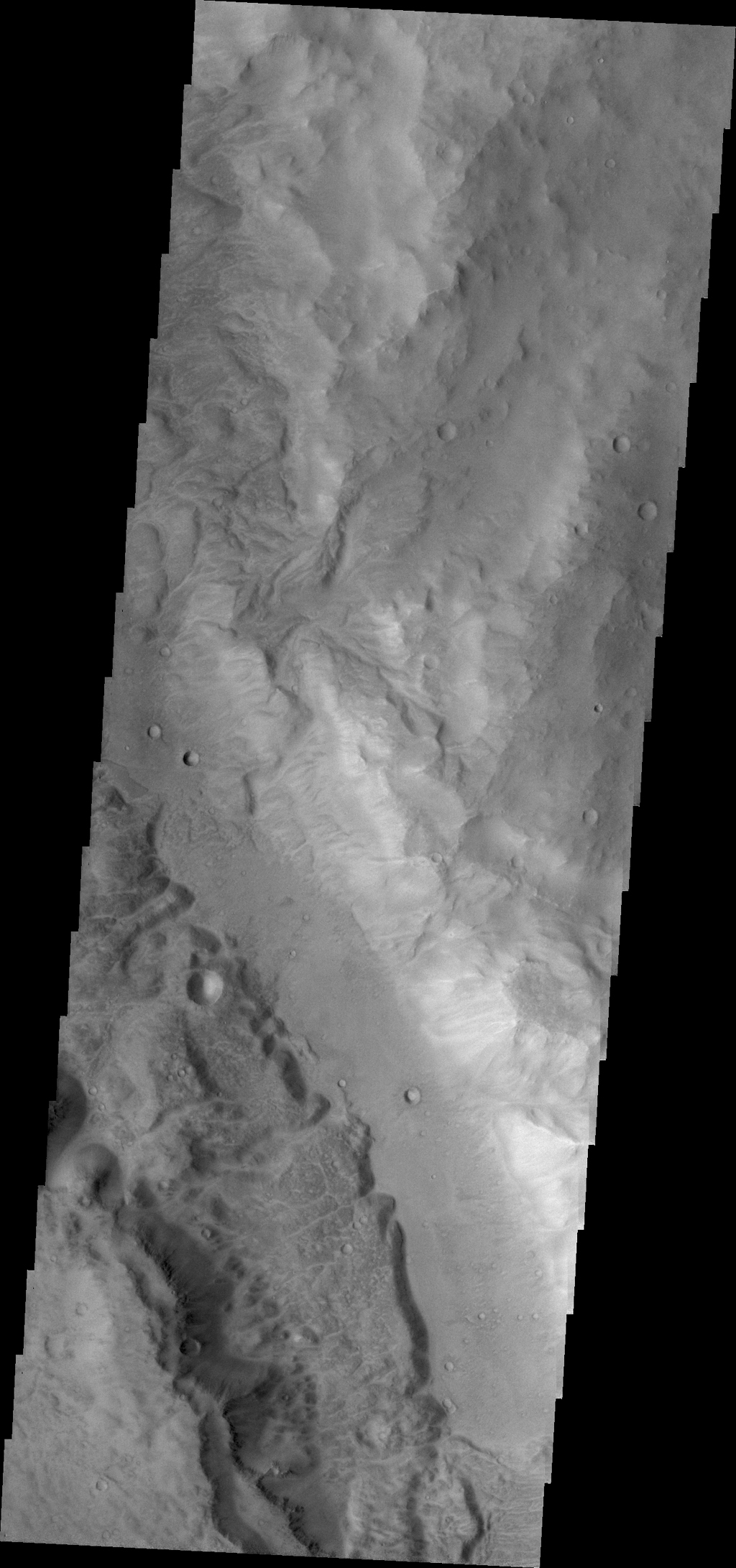 This image from NASA's 2001 Mars Odyssey spacecraft shows a small portion of Ma'adim Vallis. This channel intersects Gusev Crater, home of the Spirit Rover.