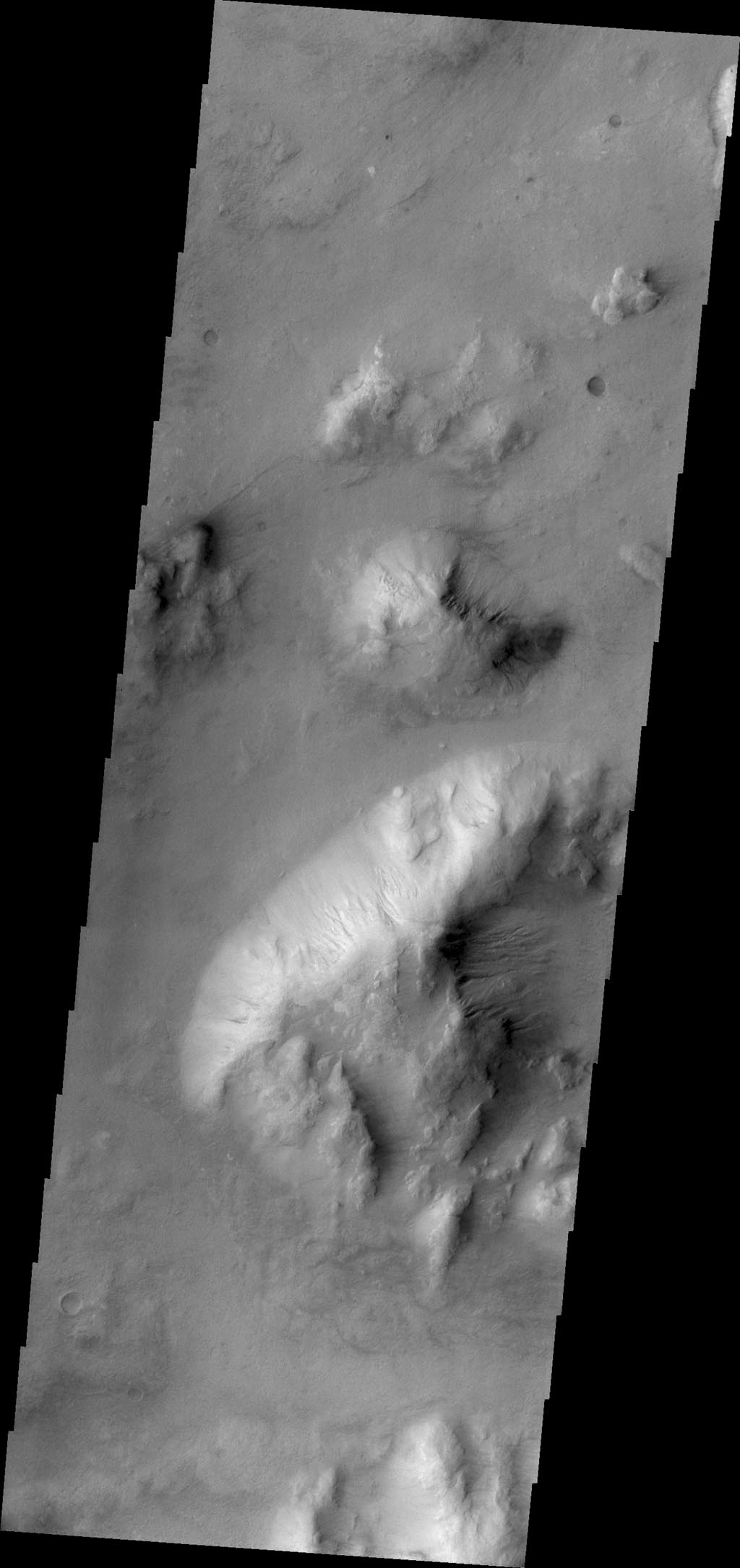 Craters are most often the site of gully formation on Mars. Mega-gullies are also found on the southwestern parts of Vallis Marineris, and in this image from NASA's 2001 Mars Odyssey spacecraft, on hills east of Argyre Planitia.