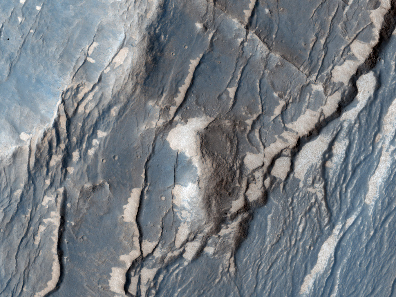 "NASA's Mars Reconnaissance Orbiter captured this image of the Claritas Fossae region, characterized by systems of ""graben."" A graben forms when a block of the planet's crust drops down between two faults, due to extension, or pulling, of the crust."