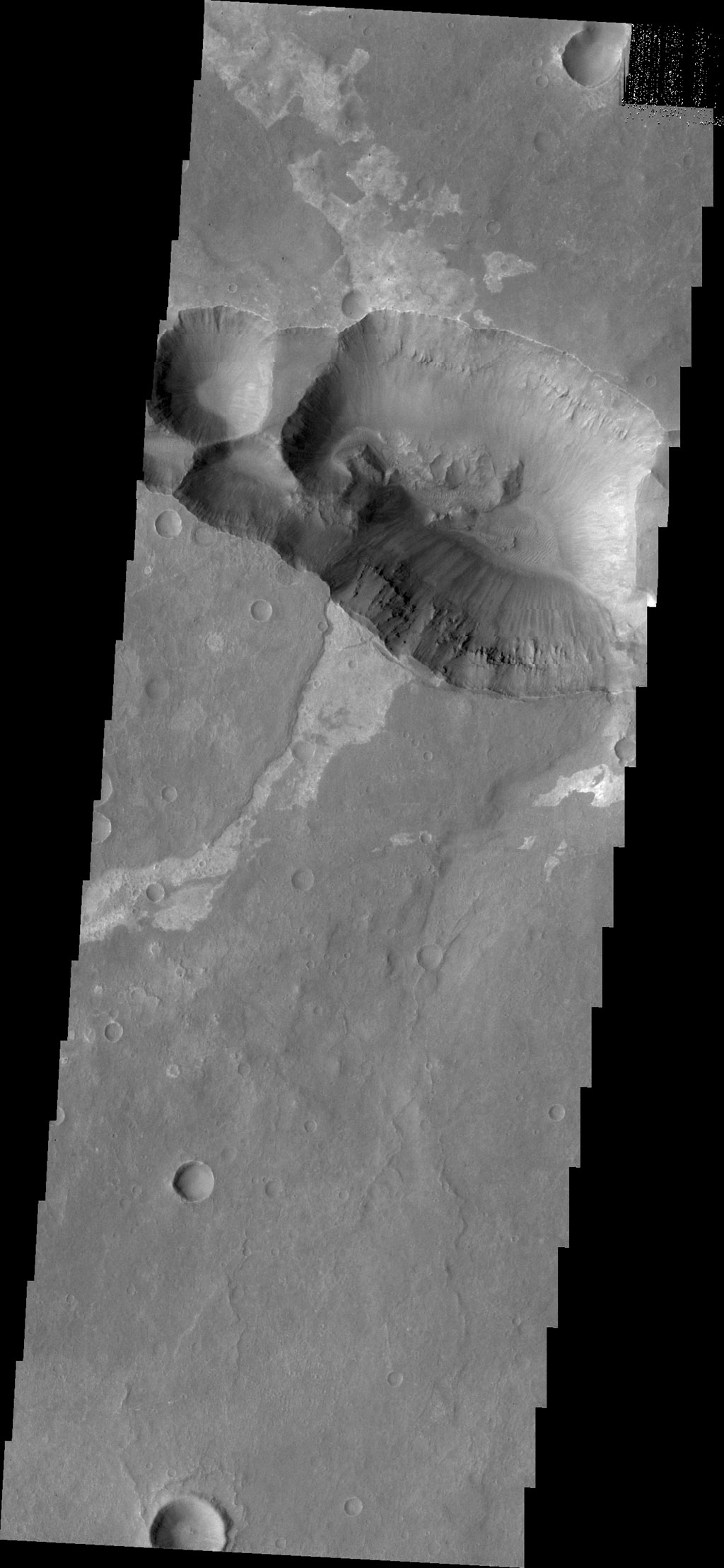 Today's image from NASA's 2001 Mars Odyssey spacecraft shows the shallower extension of Coprates Chamsa called Coprates Catena.