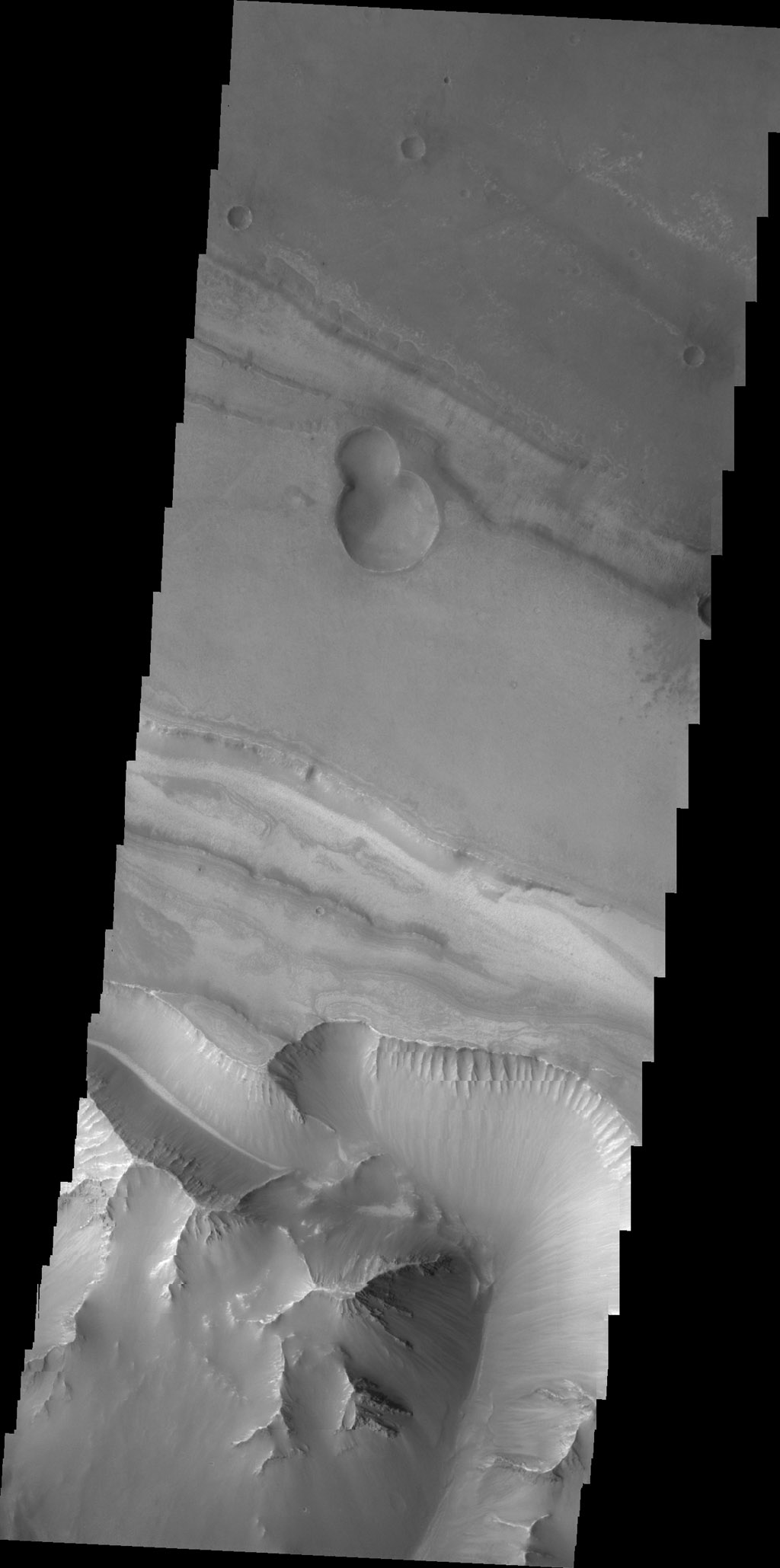 This image captured by NASA's 2001 Mars Odyssey spacecraft shows the region between Candor Chasma and Melas Chasma.