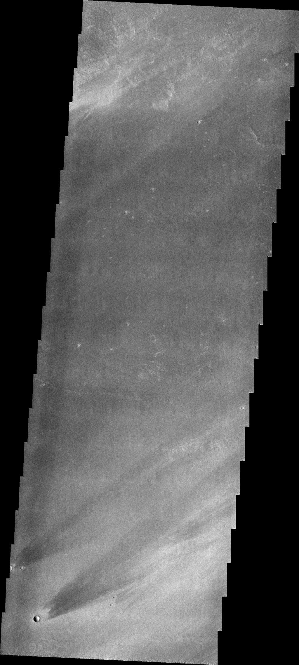 The windstreaks in this image captured by NASA's 2001 Mars Odyssey spacecraft are located on Tharsis volcanic flows east of Pavonis Mons.