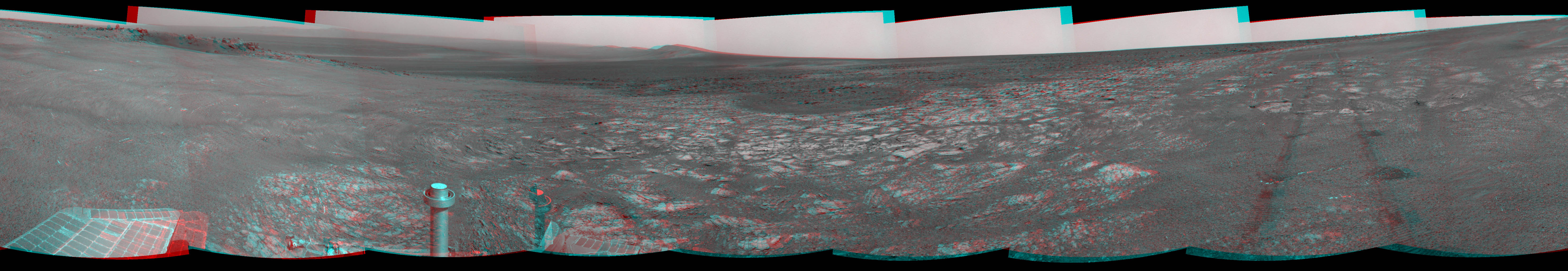 This 3-D scene shows the view from where NASA's Mars Exploration Rover Opportunity first arrived on the rim of Endeavour crater, an impact crater about 14 miles (22 kilometers) in diameter. You will need 3D glasses to view this image.
