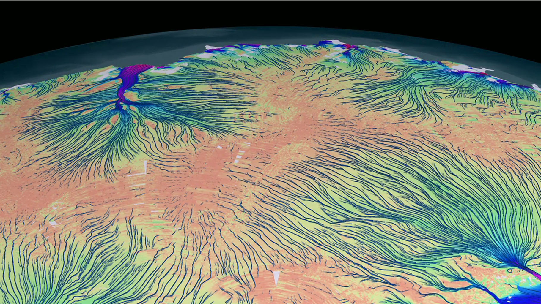 This frame from an animation shows the motion of ice in Antarctica as measured by satellite data from various space agencies. The colors represent the speed of the ice flows in meters per year.