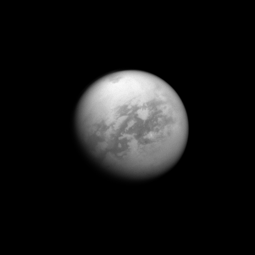 NASA's Cassini spacecraft looks toward Saturn's largest moon, Titan, and spies the huge Kraken Mare in the moon's north. Kraken Mare, a large sea of liquid hydrocarbons, is visible as a dark area near the top of the image.