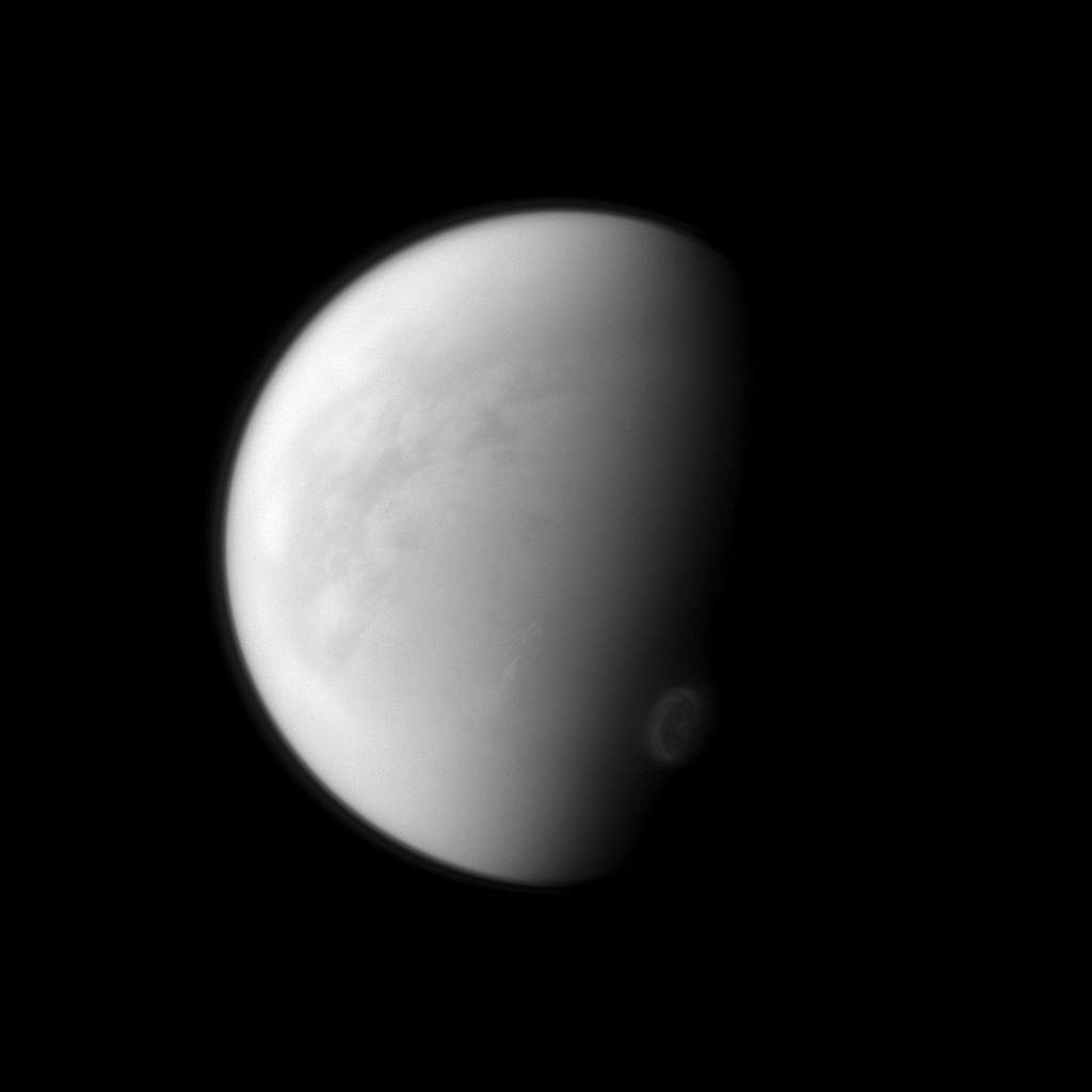 Titan's swirling south-polar vortex stands out brightly against the other clouds of the south pole (lower right) in this image captured by NASA's Cassini spacecraft.