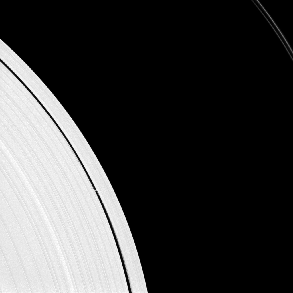 Saturn's small moon Daphnis is caught in the act of raising waves on the edges of the Keeler gap, which is the thin dark band in the left half of the image. Waves like these allow scientists to locate small moons in gaps and measure their masses.