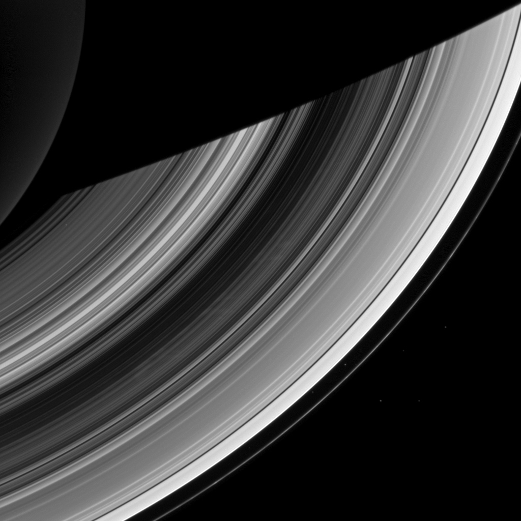 Ghostly spokes in Saturn's B ring continue to put on a show for NASA's Cassini spacecraft cameras in this recent image. The spokes, believed to be a seasonal phenomenon, are expected to disappear as Saturn nears its northern hemisphere summer.