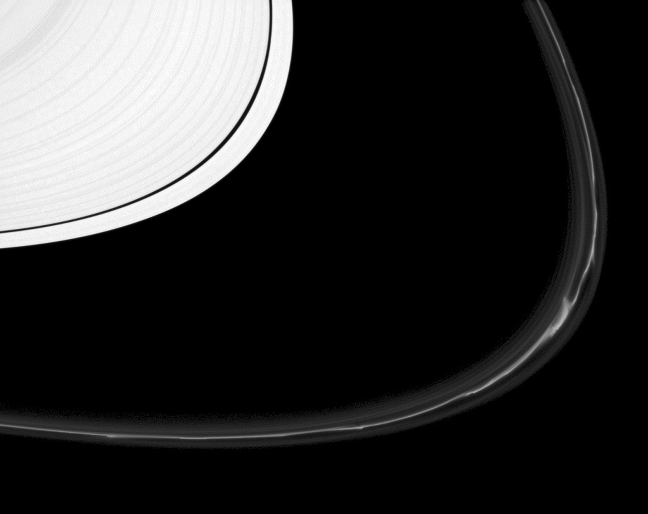 The F ring shows off a rich variety of phenomena in this image from NASA's Cassini spacecraft.