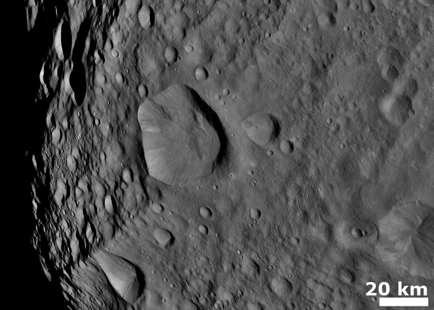 NASA's Dawn spacecraft obtained this image showing cratered terrain with hills and ridges on Vesta's surface on August 6, 2011. This image was taken through the framing camera's clear filter aboard the spacecraft.