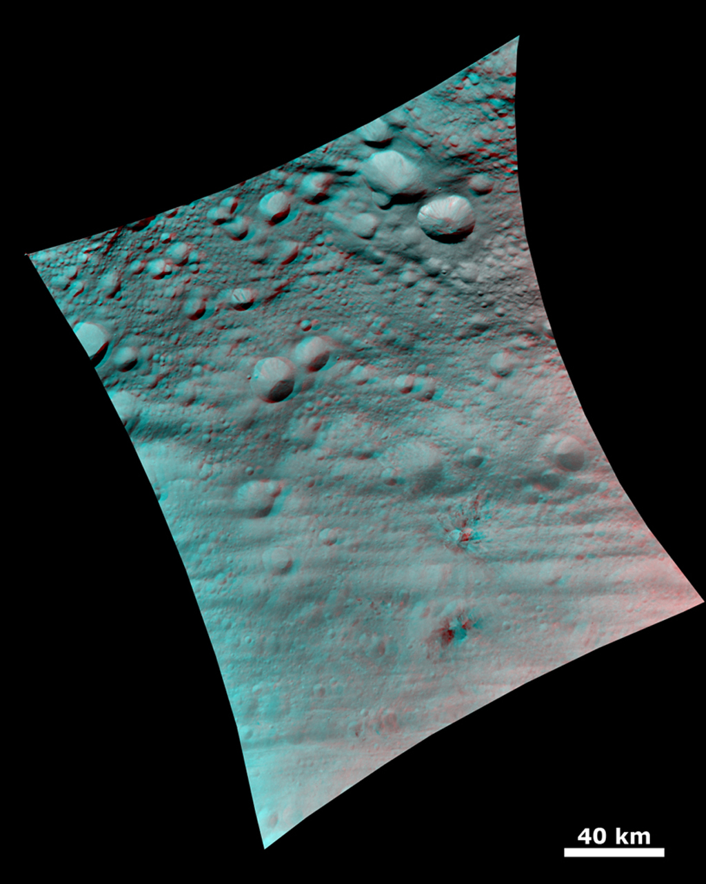 This 3-D image shows the topography of Vesta's densely cratered terrain obtained by the framing camera instrument aboard NASA's Dawn spacecraft on August 6, 2011. You need 3D glasses to view this image.