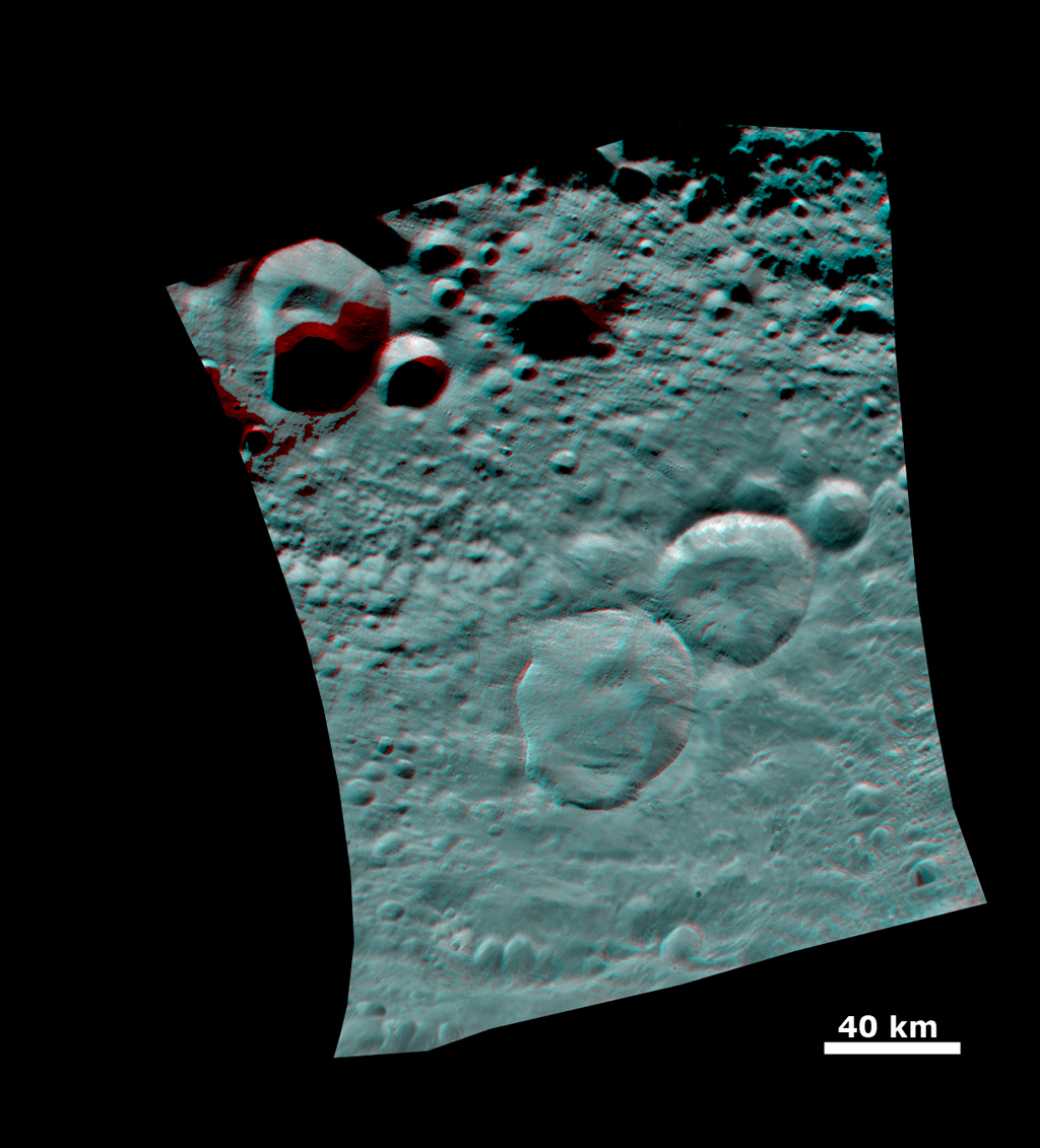 "This 3-D image shows the topography of Vesta's three craters, informally named the ""Snowman,"" obtained by the framing camera instrument aboard NASA's Dawn spacecraft on August 6, 2011. You need 3D glasses to view this image."