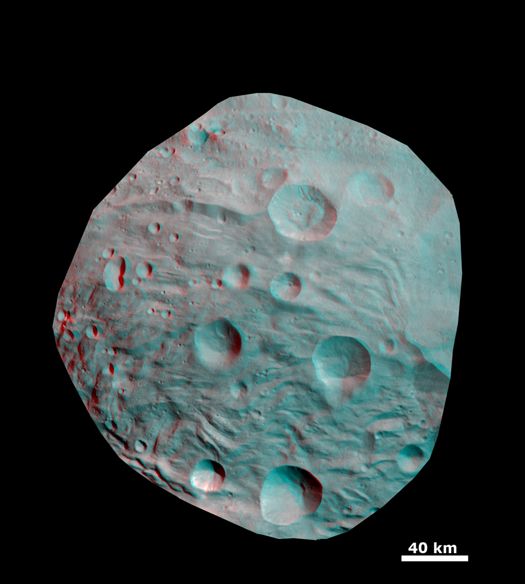 This 3-D image shows the topography of craters and grooves of asteroid Vesta's south polar region obtained by the framing camera instrument aboard NASA's Dawn spacecraft on Aug. 23 and 28, 2011. You need 3D glasses to view this image.