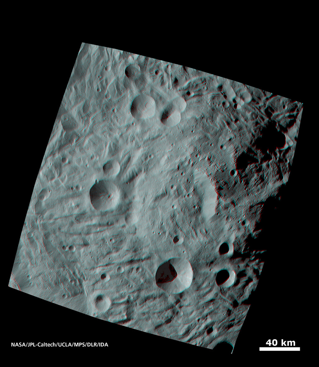 When NASA's Dawn spacecraft sent the first images of the giant asteroid Vesta to the ground, scientists were fascinated by an enormous mound inside a big circular depression at the south pole. You need 3-D glasses to view this image.