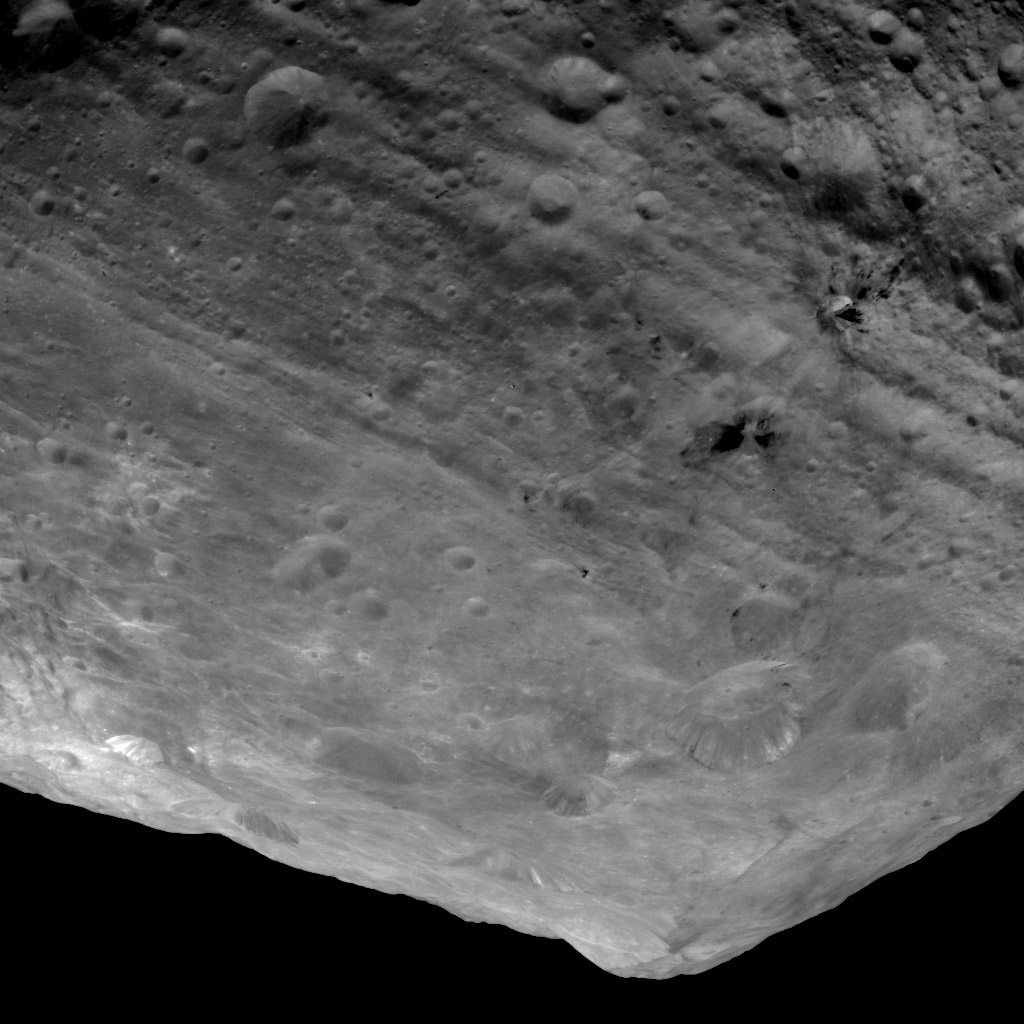 This image from NASA's Dawn spacecraft is of the south pole region of the asteroid Vesta, a mountain is rising approximately 9 miles (15 kilometers) above the floor of a crater.