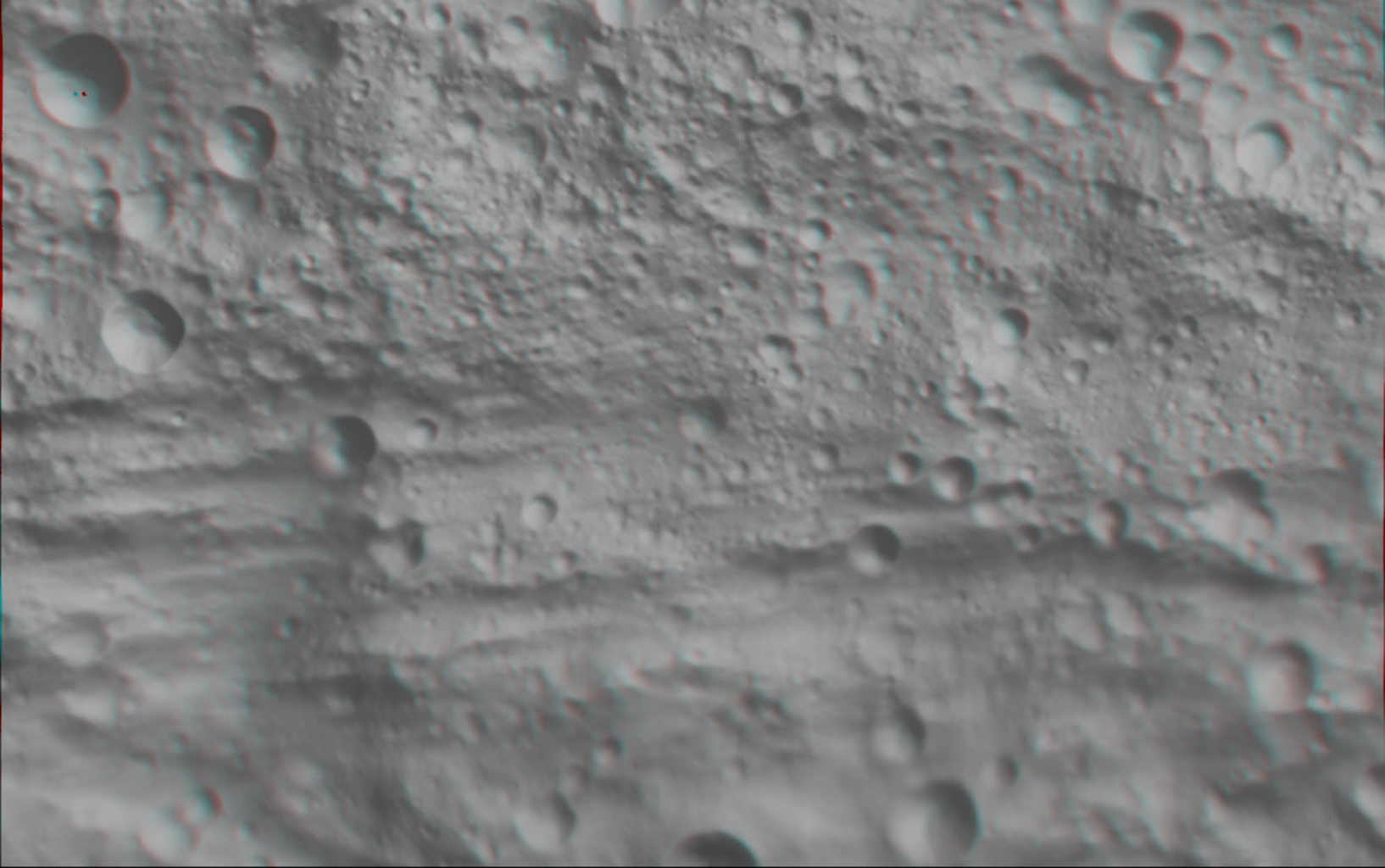 This anaglyph image shows the topography of part of Vesta's equatorial region; this uneven topography is mostly due to large, ancient, rather degraded ruin eroded craters. You need 3-D glasses to view this image.