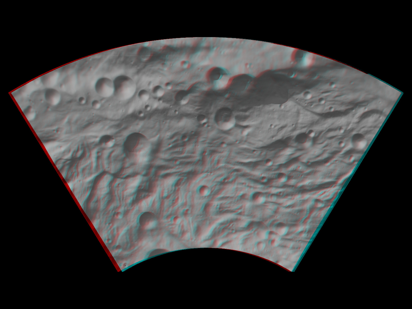 This anaglyph image shows the topography of asteroid Vesta's southwestern region. The large, heavily degraded subdued rimmed crater in the top right becomes clearer in this anaglyph image. You need 3-D glasses to view this image.