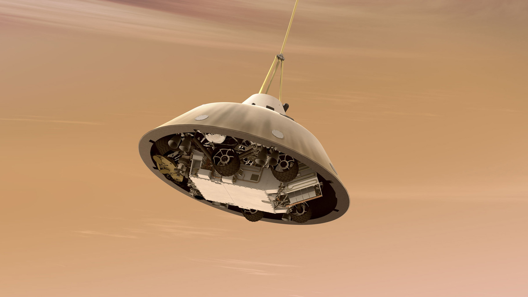 This artist's concept shows NASA's Curiosity rover tucked inside the Mars Science Laboratory spacecraft's backshell while the spacecraft is descending on a parachute toward Mars. Here, the spacecraft's heat shield has already been jettisoned.