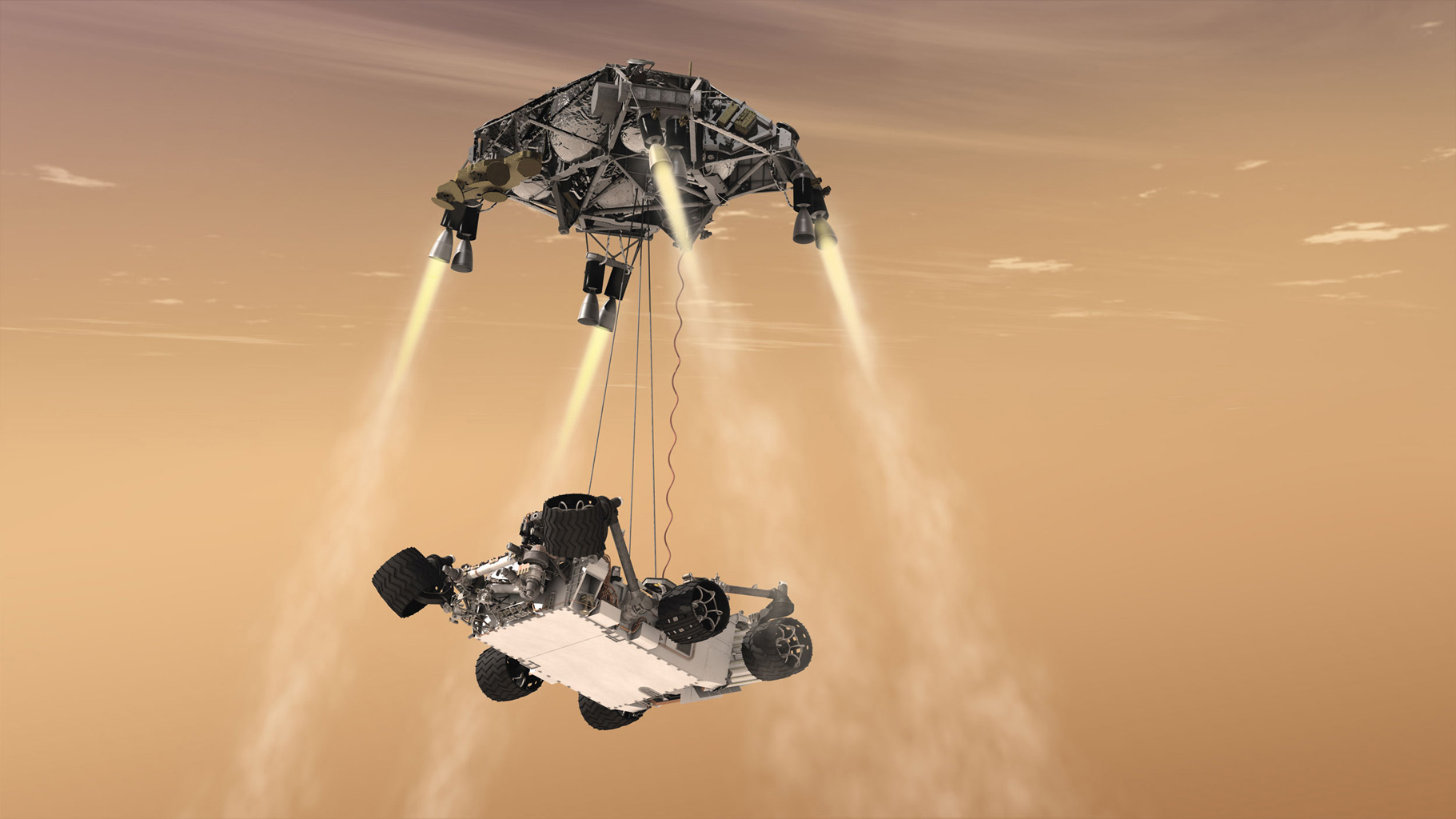 This artist's concept shows the sky crane maneuver during the descent of NASA's Curiosity rover to the Martian surface. The sheer size of the rover (over one ton, or 900 kilograms) would preclude it from taking advantage of an airbag-assisted landing.