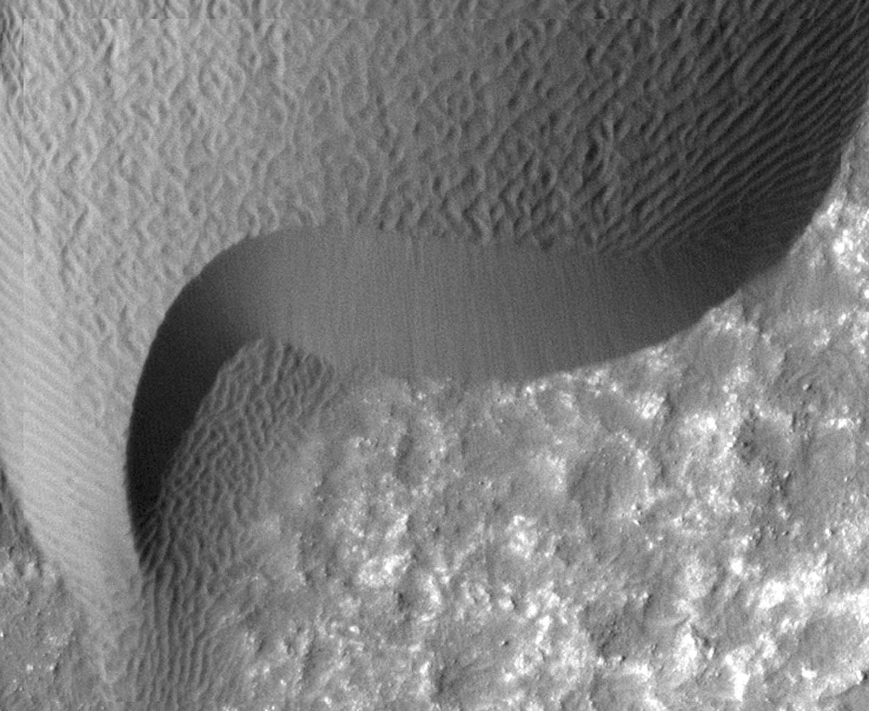 A rippled dune front in Herschel Crater on Mars moved an average of about two meters (about two yards) between March 3, 2007 and December 1, 2010, as seen in one of two images from NASA's Mars Reconnaissance Orbiter.