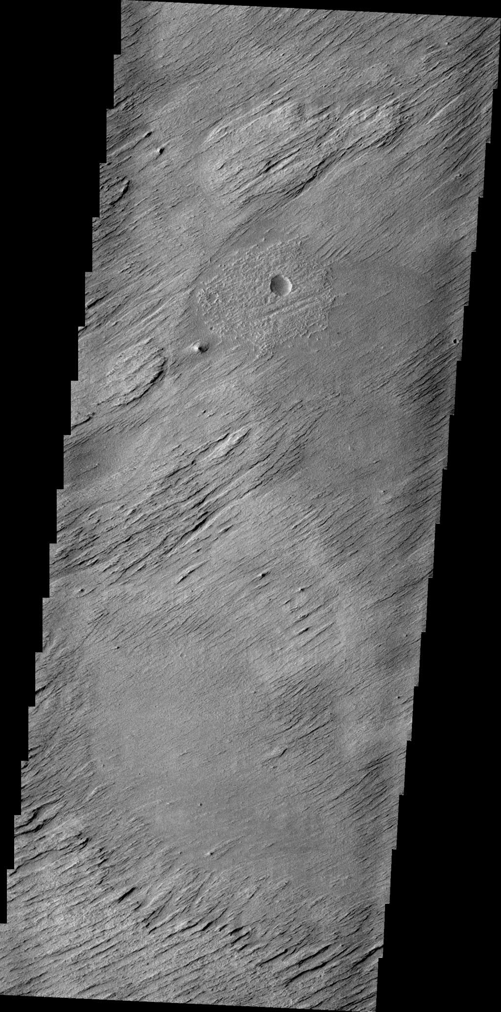 The main agent of erosion on Mars today is the wind. Wind has sculpted the surface in this region into a set of hills and valleys called yardangs on Earth. This image is from NASA's 2001 Mars Odyssey spacecraft.