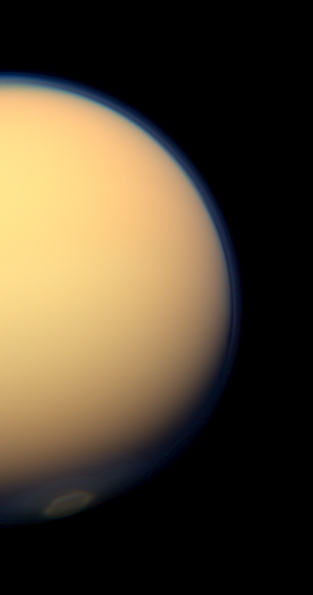 The recently formed south polar vortex stands out in the color-swaddled atmosphere of Saturn's largest moon, Titan, in this natural color view from NASA's Cassini spacecraft.