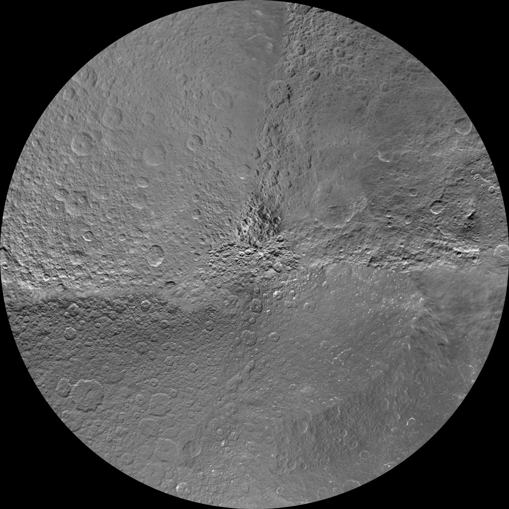 The northern and southern hemispheres of Rhea are seen in these polar stereographic maps, mosaicked from the best-available NASA's Cassini and Voyager images.