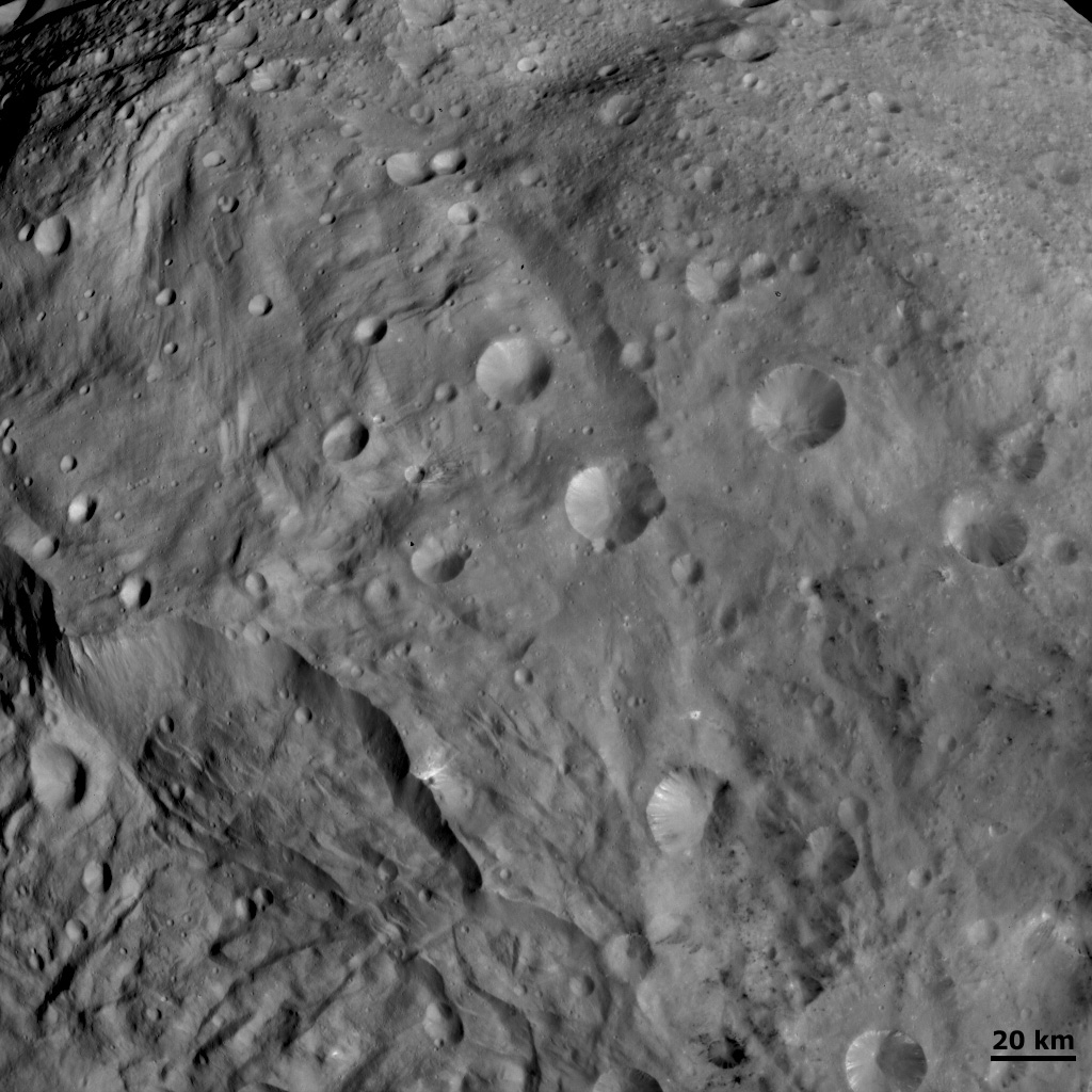 This image from NASA's Dawn spacecraft shows craters of different sizes and shapes in Vesta's southern hemisphere. The freshest craters can be classified as fresh scarp rimmed craters and the less fresh classified as partly degraded subdued rim craters.