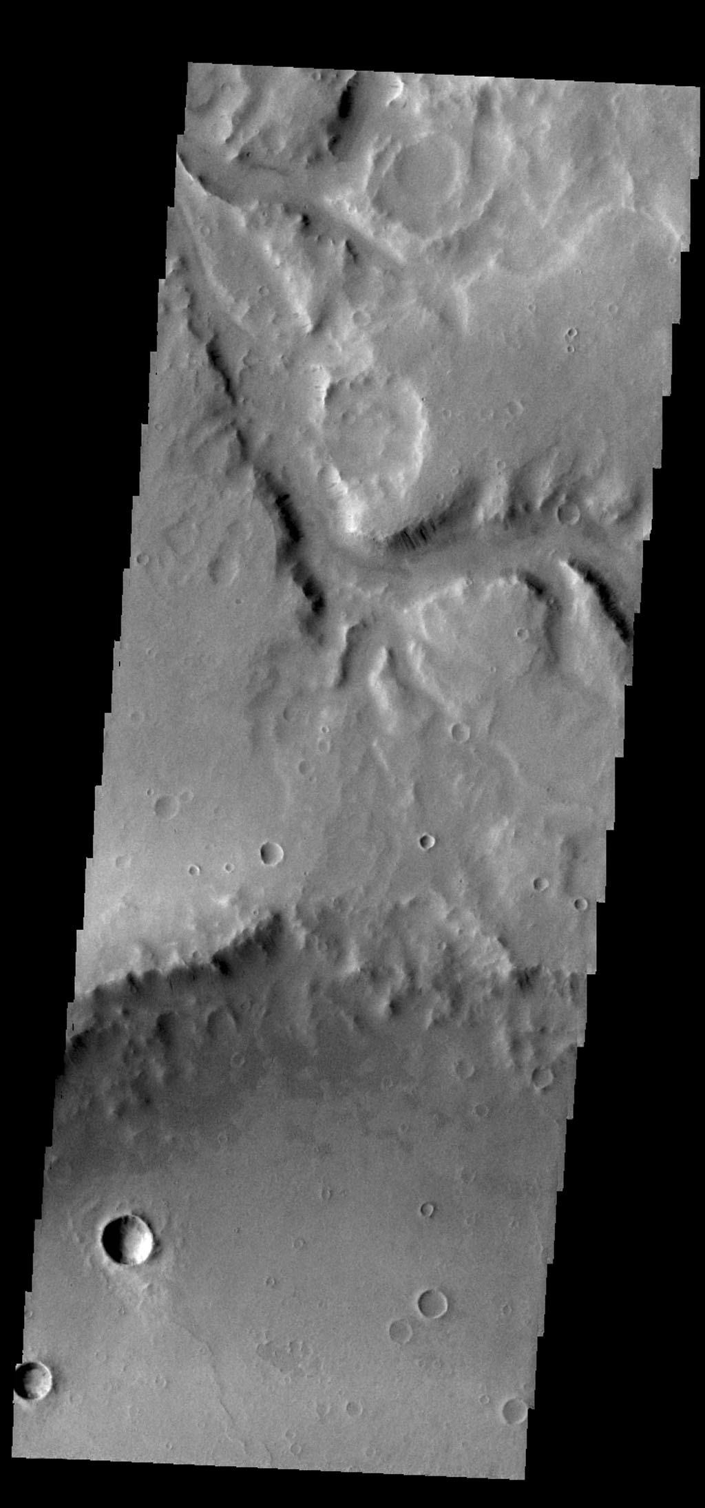This image from NASA's 2001 Mars Odyssey spacecraft shows a small section of Naktong Vallis.