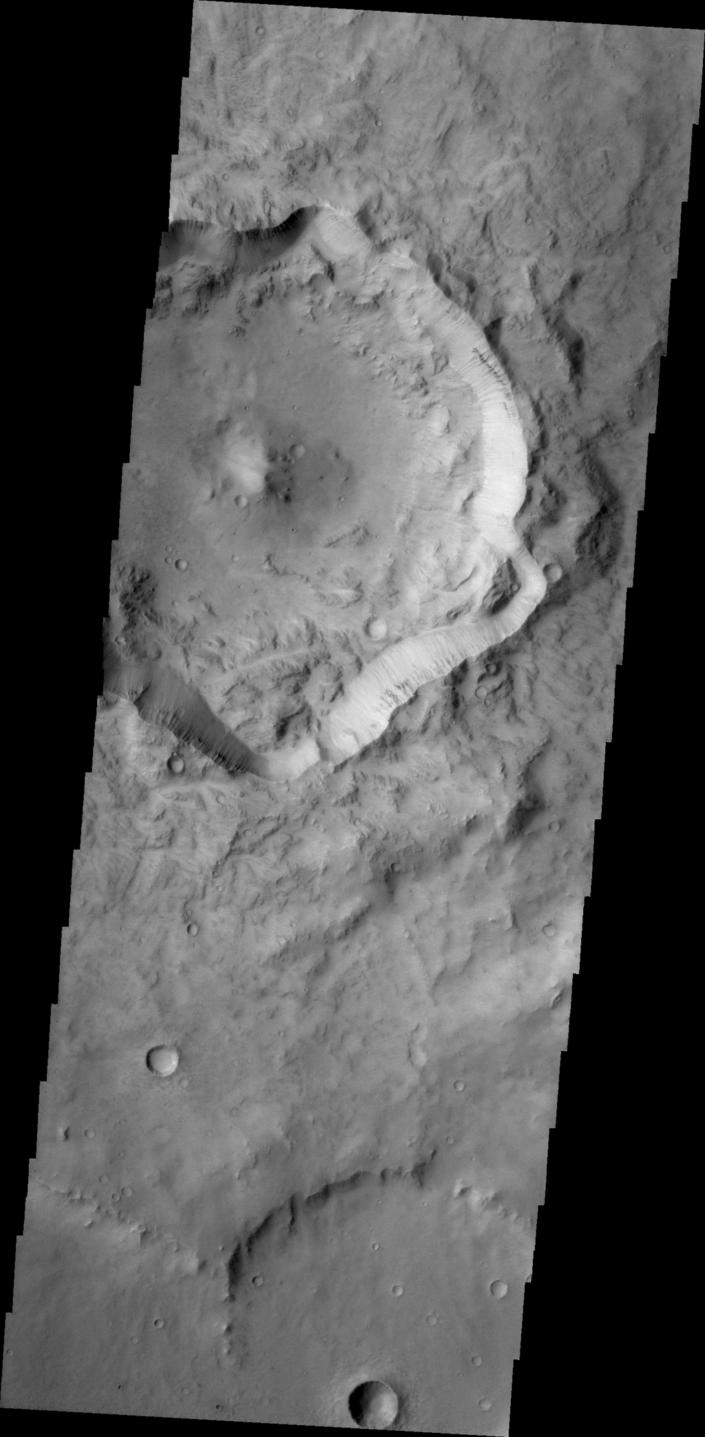 This unnamed crater in Terra Cimmeria is not as round in shape as other craters. Major landslides have occurred on the crater rim, resulting in the final shape as seen by NASA's 2001 Mars Odyssey spacecraft.