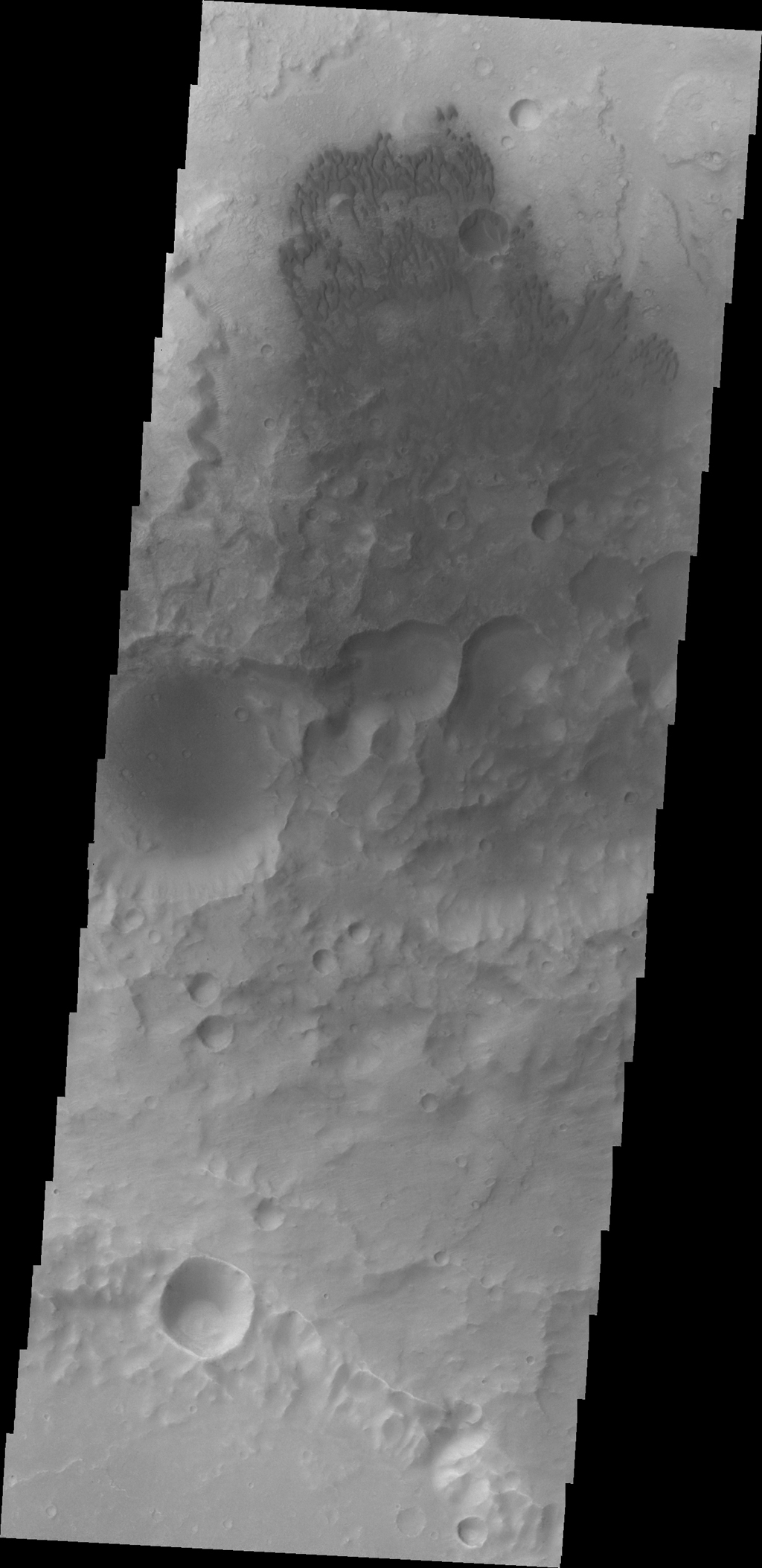 Small dunes are located on the floor of this unnamed crater in Terra Cimmeria as seen by NASA's 2001 Mars Odyssey spacecraft.