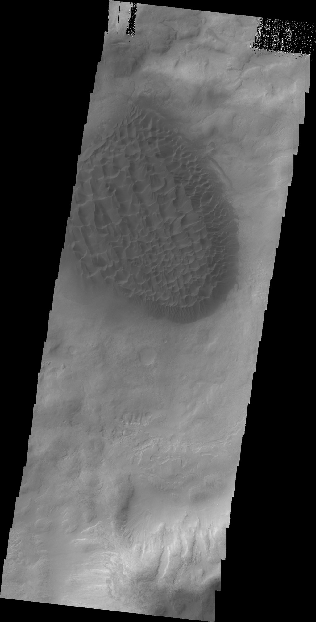A large pile of sand with dune features on its surface is located on the floor of Matara Crater as seen by NASA's 2001 Mars Odyssey spacecraft.
