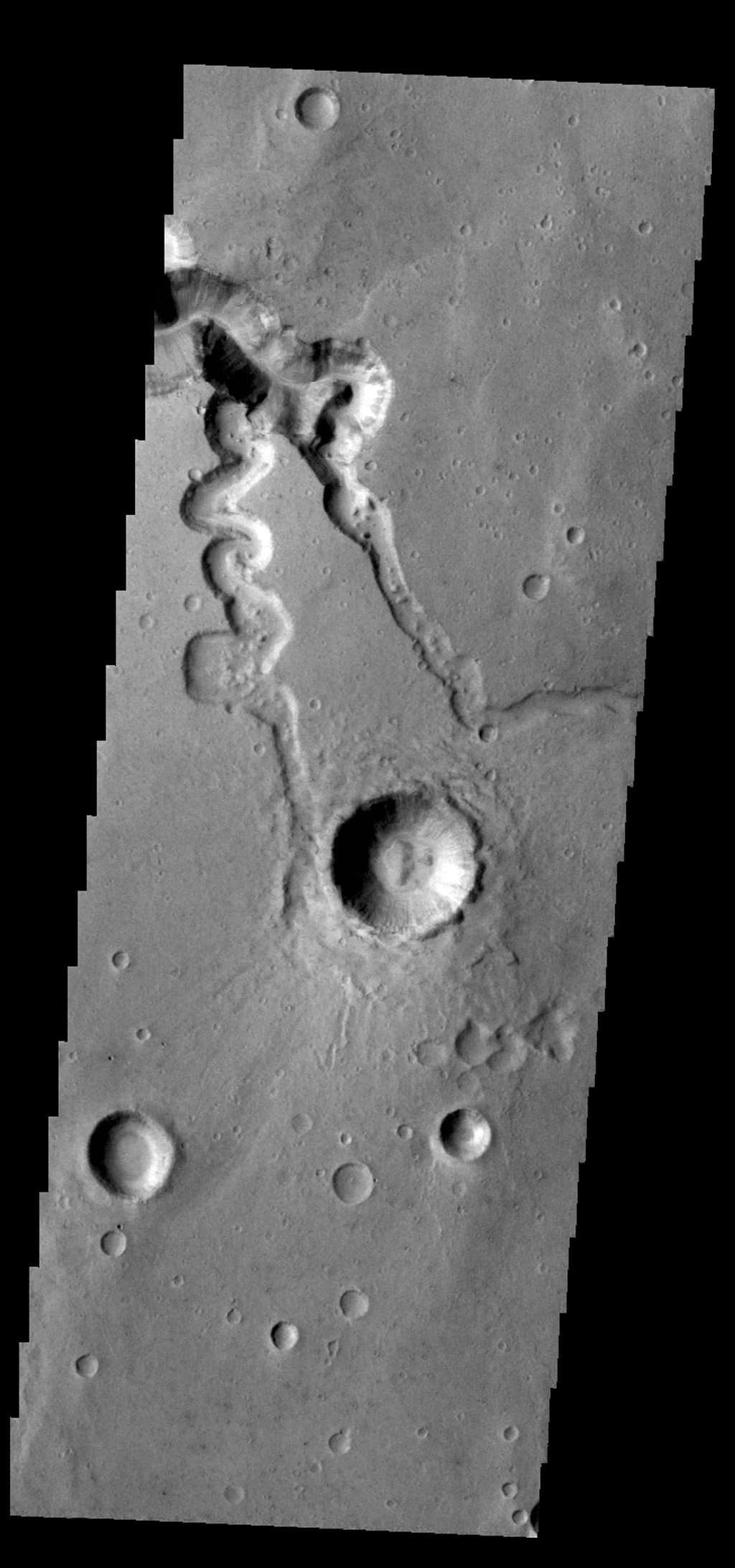 This image from NASA's 2001 Mars Odyssey spacecraft shows two small tributaries, just east of where they join Shalbatana Vallis.