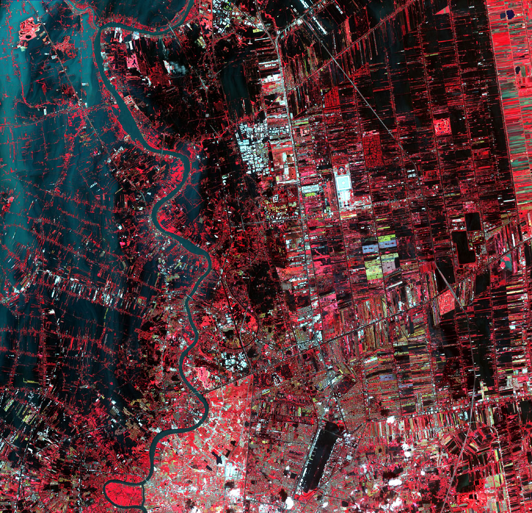 Flooding from the Chao Phraya River, Thailand, had begun to ebb in this image acquired by NASA's Terra spacecraft on Nov. 1, 2011. Here, in blue-gray is the muddy water that had overflowed the banks of the river, flooding agricultural fields and villages.